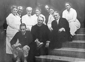 Left to right, back row: Marianna Matthews (married to Mortimer), Wm. Cooper Procter, Jane (Jean) Johnston Procter (Married to Wm. Cooper), Olivia Benedict, Cleveland Benedict, Bessie Rogan, Elsie Matthews (Married to Rev. Paul). On steps left to right: Ralph Rogan, Rev. Paul Matthews, Mortimer Matthews